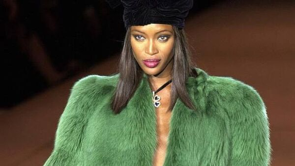 Naomi Campbell sports a green open coat during French legendary fashion designer Yves Saint Laurent's farewell show Tuesday Jan.22, 2002 in Paris.AP PHOTO/Remy de la Mauviniere