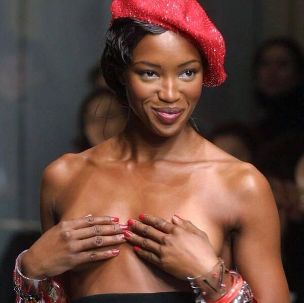 Naomi Campbell hides her breast while presenting a red sequinned beret and a black dress during Jean-Paul Gaultier spring-summer 2002 Haute Couture's collection Sunday Jan.20, 2002 in Paris. Photo: AP Photo / Michel Euler