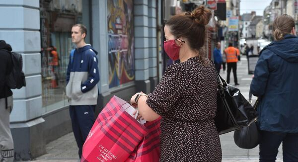 A woman wearing a face mask on Patrick Street, Cork. Picture: Dan Linehan