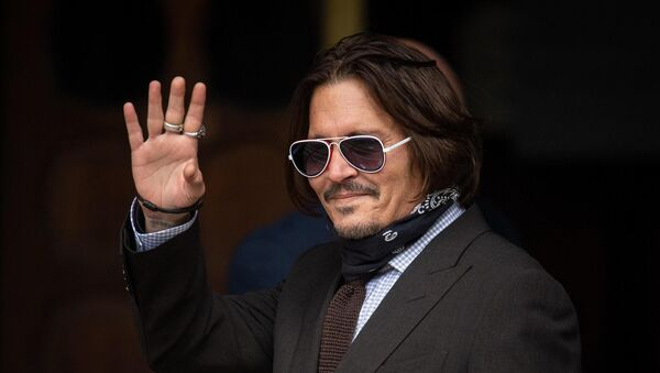 Actor Johnny Depp arrives at the High Court in London to give evidence in his libel case against the publishers of The Sun and its executive editor, Dan Wootton. Picture: Dominic Lipinski/PA Wire