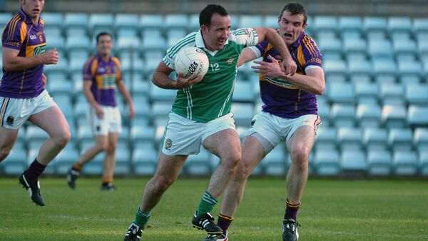 Kieran O'Connor in action for Aghada in 2013 against Graham Canty of Carbery. Picture: Larry Cummins