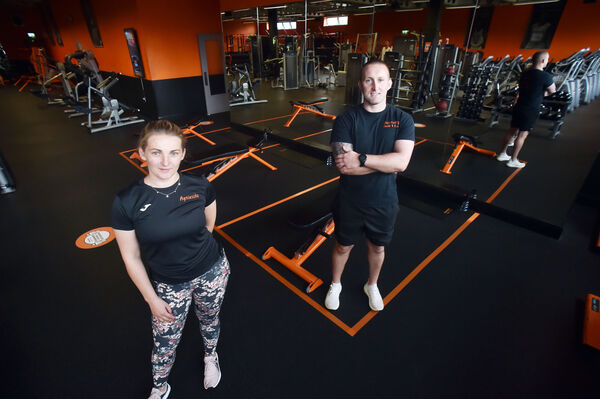 """You can't operate at full capacity, so you can't make the money you were making before you were closed."" Luke Dennehy, proprietor of Dennehy's Gym in Blackpool with personal trainer Agnieszka Deffzatt. Picture: Eddie O'Hare"