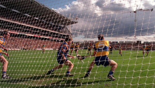 Joe Errity of Offaly blasts a penalty to the  net past Clare goalkeeper Davy Fitzgerald, centre, and his team-mates Anthony Daly, left, and Liam Doyle, right, during the 1998 All-Ireland semi-final replay