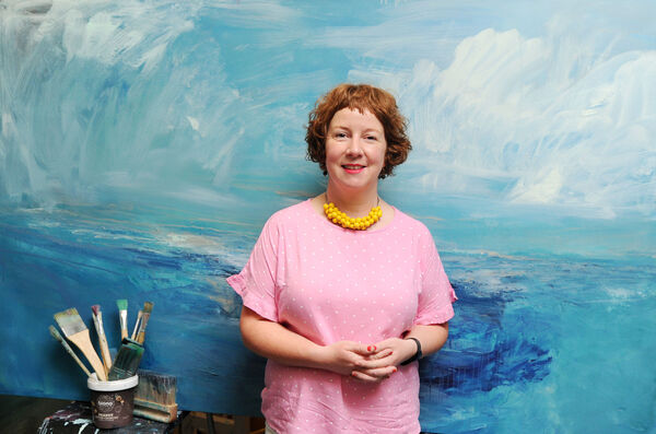 Artist Cora Murphy in Cork, with one of her paintings of the sea. Picture: Denis Minihane