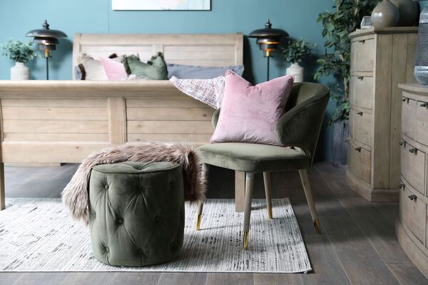 Velvet and button upholstery give a touch of luxury to the Sofia pouffe finished in sage green (€149 at EZ Living Interiors).