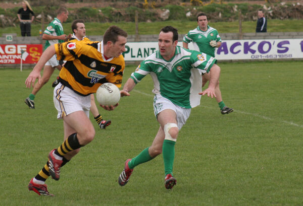 Kieran O'Connor in action for Aghada against John Gardiner of Na Piarsaigh in 2006.