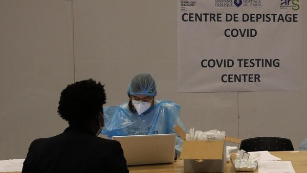 Medical staff take charge of passengers in a COVID-19 testing center, set up in the arrival hall of the Charles de Gaulle international airport in Roissy, north of Paris, Friday, July 24, 2020. Picture: AP Photo/Christophe Ena