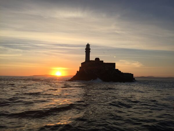 Fastnet Rock Lighthouse bursts out of the Atlantic with all the symbolic pomp of an Irish Statue of Liberty.