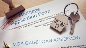 June mortgage approvals down 50% from year-earlier level