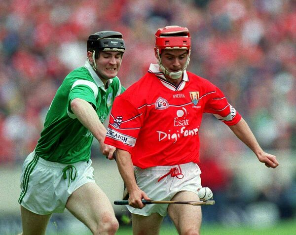 Cork's Sean McGrath of Cork evades Limerick's Stephen Lucey in the 2000 Munster SHC semi-final at Semple Stadium. Photo by Ray McManus/Sportsfile