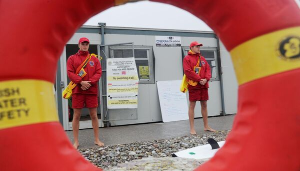 Brothers John (left) and James Walshe, lifeguards at Garryvoe beach in Co Cork. Picture: Denis Minihane