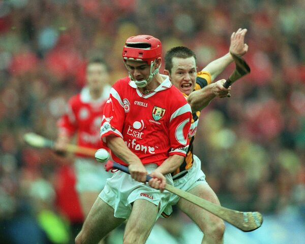 Cork hurler Seanie McGrath fires over a point despite the challege of Michael Kavanagh of Kilkenny in the 1999 All-Ireland hurling final at Croke Park. Picture: INPHO/Patrick Bolger
