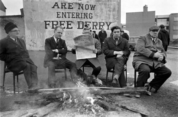 John Hume sits by a by fire in an early morning demonstration in Derry in February 1972. Picture: Watford/Mirrorpix/Mirrorpix/Getty