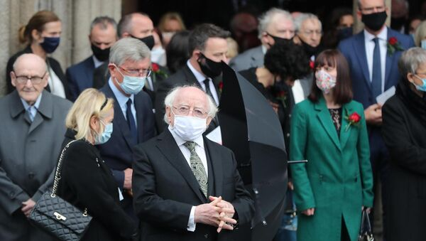 President of Ireland Michael D. Higgins stands with mourners following the funeral service of the former SDLP leader John Hume at St Eugene's Cathedral Picture: Niall Carson/PA Wire