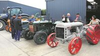 Michael Fahy collects vintage tractors... and deserving causes