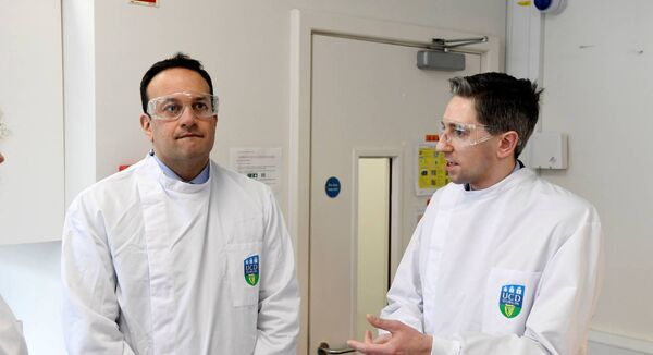 Taoiseach Leo Varadkar and Minister for Health Simon Harris (right) during a visit to the UCD National Virus Reference Laboratory, University College Dublin, in Belfield, Dublin. (Aidan Crawley/PA Wire)