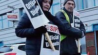 Hundreds of health and social care workers strike over pay