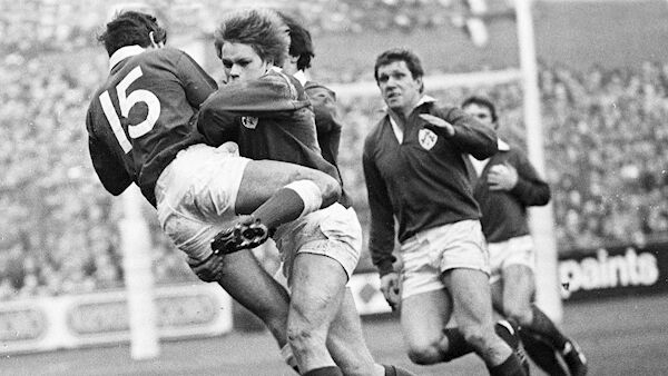 Irish winger Trevor Ringland tackles Welsh full-back Gwyn Evans. Picture: Irish Examiner Archive