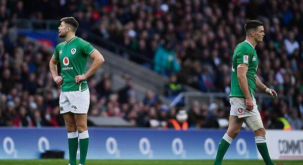 FUTURE AND PRESENT: Ross Byrne, left, and Jonathan Sexton ponder the road ahead after Ireland's Six Nations mauling against England at Twickenham on Sunday.  	Picture: Ramsey Cardy/Sportsfile