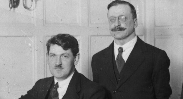 Michael Collins and Arthur Griffith.