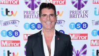 Simon Cowell breaks back