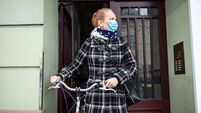 Woman with a face mask going out with her bicycle