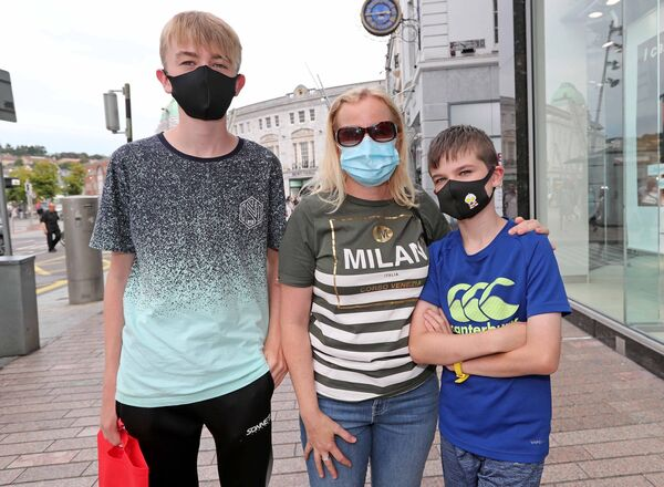 "Fiona O'Donovan pictured with her sons Derren and Ciarán. Derren says wearing a mask is ""no big deal."""