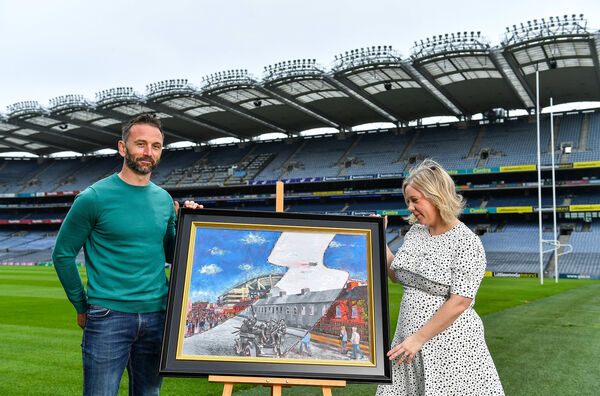 Artist David Sweeney shows his specially-commissioned Bloody Sunday commemoration artwork to GAA Museum Education and Events Manager, Julianne McKeigue, a descendent of Tipperary footballer Michael Hogan who was killed during the attack.