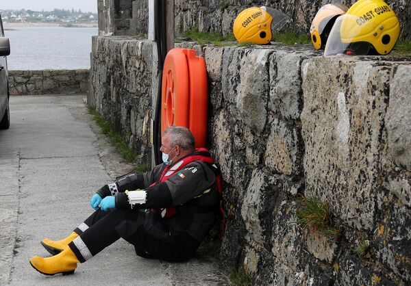 A member of the Irish Coast Guard after hearing the news of the rescue. Picture: Hany Marzouk