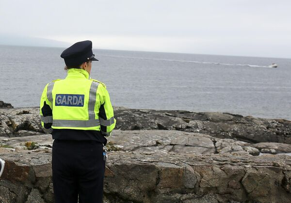 Local Garda keeping her eye on the sea during the search for the missing Paddle boardes girls at the Galway Bay. Photo: Hany Marzouk