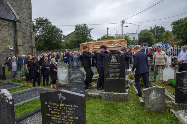 P.J. ( Paddy ) Sheehan is shouldered to his resting place in adjoining cemetery at the Church of Our Lady, Star of the Sea and St Patrick's in Goleen, West Cork. Picture Dan Linehan