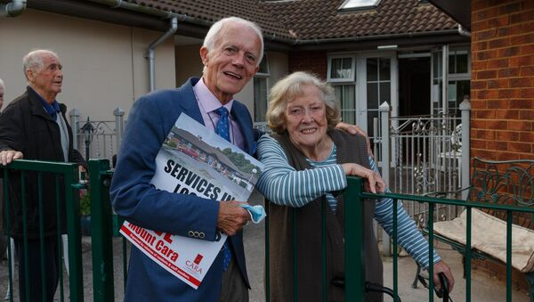 Campaigner Paddy O Brien with Mount Cara resident Jenny Martin (92) at a vigil held as part of the campaign to prevent the closure of Cara House. Picture: Damian Coleman