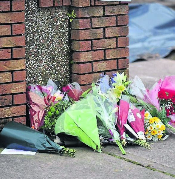 Flowers left outside the home.	Picture: Dan Linehan