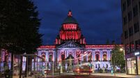 Belfast buildings lit up red for Polish Solidarity movement