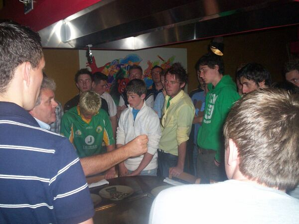 Adrian Logan talking to Thomas Clarkes players on a trip to San Francisco in 2008. Current players Patrick Quinn in green hoodie and Kiefer Morgan blond hair with head bowed will feature in Sunday's Tyrone SFC final.