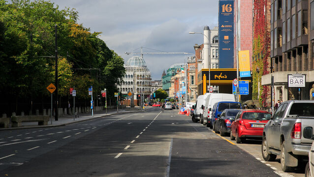 <p>A quiet Stephen's Green Square as the level-three restrictions take hold on Dublin City. Picture: Gareth Chaney</p>