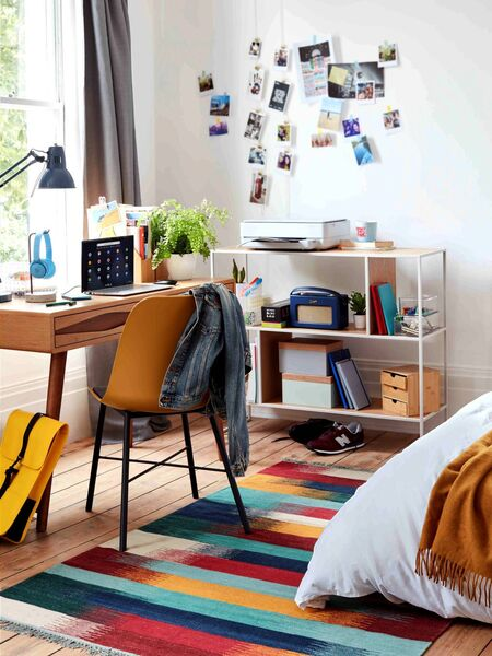 House by John Lewis range: Dice shelving unit, Whistler dining chair, Frequency desk,a Bright Stripe rug.