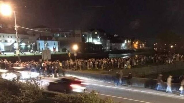 <p>The crowds present at Galway's Spanish Arch on Monday night. Picture: Cllr Eddie Hoare/Twitter</p>