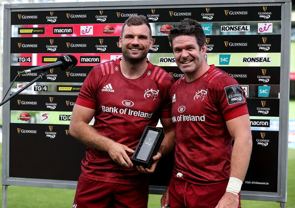 Billy Holland presents Tadhg Beirne with the Guinness PRO14 Player of the Match Award against Connacht. Picture: INPHO/Dan Sheridan