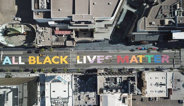 The words 'All Black Lives Matter' painted on Hollywood Boulevard in June prior to a march against racism and police brutality in the wake of the killing of George Floyd by Minneapolis police. Picture: Robyn Beck/AFP