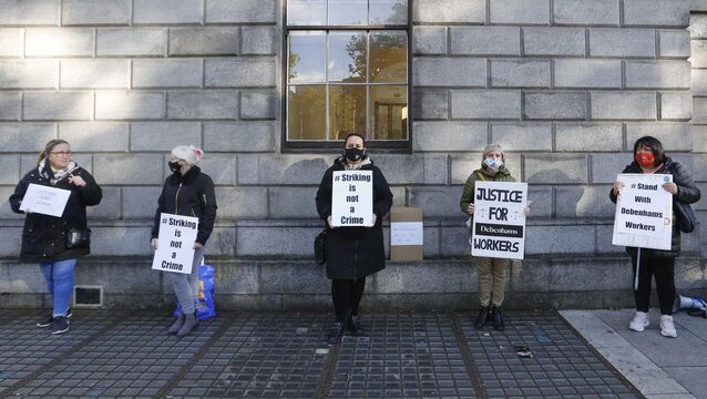 <p>Former Debenhams employees, who were made redundant earlier this year, protest outside the Four Courts today. Photo: RollingNews.</p>
