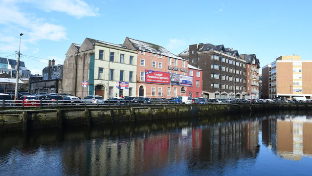<p>The former Moore's Hotel, and adjacent buildings on Morrison's Quay. The decision to grant planning for a redevelopment of the site has been appealed to An Bord Pleanála. Picture: Larry Cummins</p>