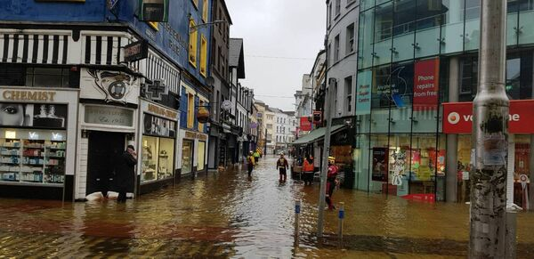 Flooding along Oliver Plunkett Street this morning. Picture: Stephen Rogers