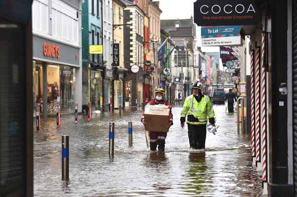 The civil defence and Cork fire serrvice dealing with the flooding on Oliver Plunkett Street, Cork. Picture Dan Linehan