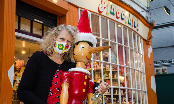 Christel Stansfeld bringing in Pinnochio from outside her toy shop in Paul Shop as the store closes for up to six weeks due to Level 5 lockdown. Picture: Howard Crowdy