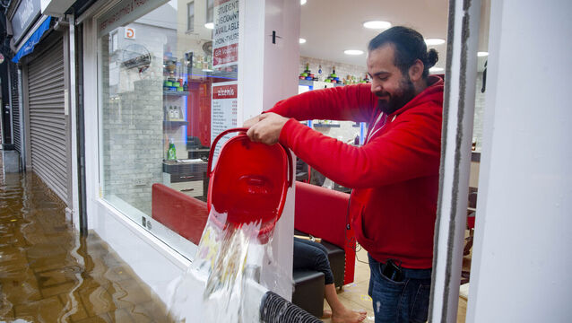 <p>Staff clean up in Zizenia Barbers during Tuesday's flooding. Picture: Daragh Mc Sweeney/Provision</p>