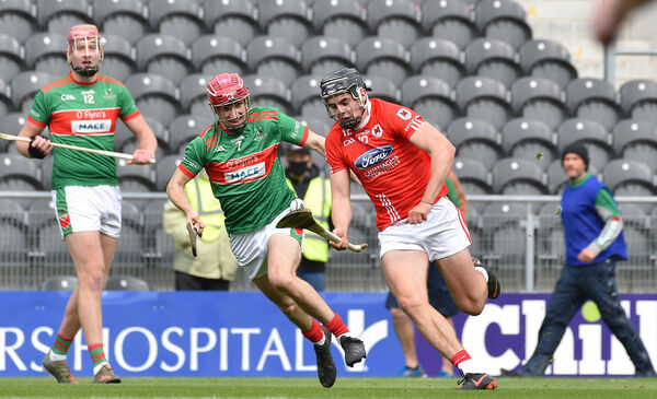 Darragh Fitzgibbon, Charleville going past Tomas Mellerick, Fr. O'Neill's during the Cork SAHC final. Picture: Dan Linehan