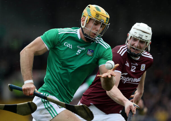 Limerick's Dan Morrissey and Joe Canning of Galway. Picture: INPHO/Lorraine O'Sullivan