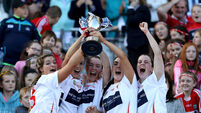 Sarah Harrington, Leah Weste, Sarah Buckley, Niamh Ní Chaoimh and Finola Neville celebrate with the the Jack McGrath Cup 9/9/20