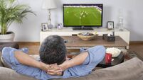 man watching football match at home